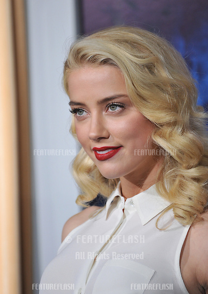 "Amber Heard at the Los Angeles premiere of ""Sherlock Holmes: A Game of Shadows"" at the Village Theatre, Westwood..December 6, 2011  Los Angeles, CA.Picture: Paul Smith / Featureflash"