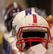 Helmets await to be auctioned off at the 9th annual Bill Dooley Pigskin Preview. The helmets sold as follows: Duke $2000, ECU $1100, UNC $1000, NCCU $1000 (bought by Duke coach David Cutcliffe), and NCSU $800. Photo by Al Drago.