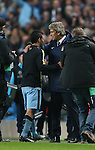 Manuel Pellegrini manager of Manchester City greets the winning goal scorer Sergio Aguero of Manchester City on the final whistle - UEFA Champions League group E - Manchester City vs Bayern Munich - Etihad Stadium - Manchester - England - 25rd November 2014  - Picture Simon Bellis/Sportimage