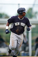 GCL Yankees designated hitter Isiah Gilliam (83) runs to first during the second game of a doubleheader against the GCL Pirates on July 31, 2015 at the Pirate City in Bradenton, Florida.  The game was suspended after two innings due to rain.  (Mike Janes/Four Seam Images)