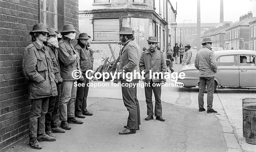 Masked members of the loyalist para-military Ulster Defence Association on duty in the predominently Protestant Woodvale district of Belfast, N Ireland, UK, on 14th May 1972. 197205140563d<br />