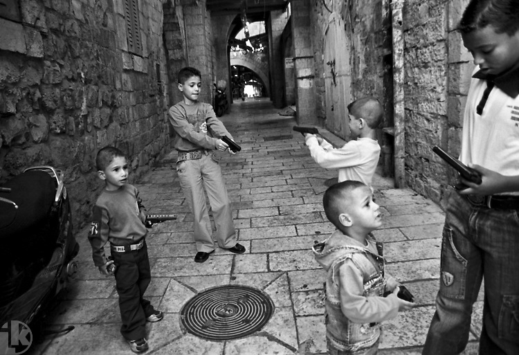 Palestinian children at play. All too realistic toy guns are everywhere, war and Arab - Jewish conflict the predominant theme in the Muslim Quarter.