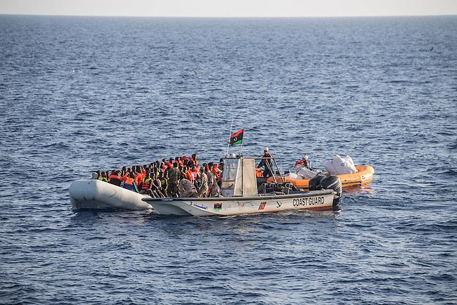 Sea Watch-2.<br /> Die Sea Watch-2 bei ihrer 13. SAR-Mission vor der libyschen Kueste.<br /> Im Bild: Ein Schlauchboot mit ca. 160 Menschen wird von der Sea Watch-Crew mit Rettungswesten versorgt.<br /> Die Aktion wird von einem Boot das sich als libysche Kuestenwache ausgibt unterstuetzt.<br /> 20.10.2016, Mediterranean Sea<br /> Copyright: Christian-Ditsch.de<br /> [Inhaltsveraendernde Manipulation des Fotos nur nach ausdruecklicher Genehmigung des Fotografen. Vereinbarungen ueber Abtretung von Persoenlichkeitsrechten/Model Release der abgebildeten Person/Personen liegen nicht vor. NO MODEL RELEASE! Nur fuer Redaktionelle Zwecke. Don't publish without copyright Christian-Ditsch.de, Veroeffentlichung nur mit Fotografennennung, sowie gegen Honorar, MwSt. und Beleg. Konto: I N G - D i B a, IBAN DE58500105175400192269, BIC INGDDEFFXXX, Kontakt: post@christian-ditsch.de<br /> Bei der Bearbeitung der Dateiinformationen darf die Urheberkennzeichnung in den EXIF- und  IPTC-Daten nicht entfernt werden, diese sind in digitalen Medien nach &sect;95c UrhG rechtlich geschuetzt. Der Urhebervermerk wird gemaess &sect;13 UrhG verlangt.]