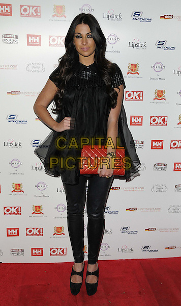 Cara Kilbey.The OK! magazine Christmas party, Sway Bar, London, England..November 27th, 2012.full length top tulle leather trousers red clutch bag hand on hip black.CAP/CAN.©Can Nguyen/Capital Pictures.
