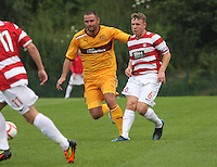 Conner McGlinchey (right) beats Michael Higdon to the ball in the Hamilton Academical v Motherwell friendly match played at New Douglas Park, Hamilton on 24.7.12..
