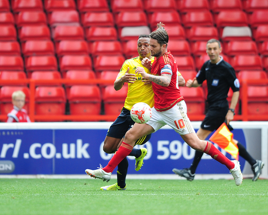Middlesbrough's Emilio Nsue vies for possession with Nottingham Forest's Henri Lansbury<br /> <br /> Photographer Chris Vaughan/CameraSport<br /> <br /> Football - The Football League Sky Bet Championship - Nottingham Forest v Middlesbrough - Saturday 19th September 2015 - City Ground - Nottingham<br /> <br /> &copy; CameraSport - 43 Linden Ave. Countesthorpe. Leicester. England. LE8 5PG - Tel: +44 (0) 116 277 4147 - admin@camerasport.com - www.camerasport.com