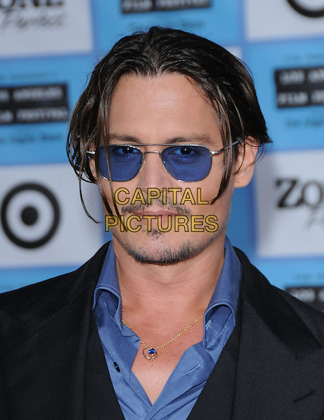 "JOHNNY DEPP.The Los Angeles Film Festival 2009 Premiere of Universal Pictures' ""Public Enemies"" held at The Mann's Village Theatre in Westwood, California, USA. .June 23rd, 2009 .headshot portrait black blue sunglasses shades stubble facial hair greasy hair.CAP/DVS.©Debbie VanStory/Capital Pictures."