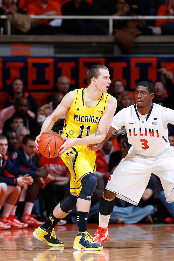 CHAMPAIGN, IL - JANUARY 27: Nik Stauskas #11 of the Michigan Wolverines handles the ball against Brandon Paul #3 of the Illinois Fighting Illini during the game at Assembly Hall on January 27, 2013 in Champaign, Illinois. Michigan defeated Illinois 74-60. Nik Stauskas;Brandon Paul