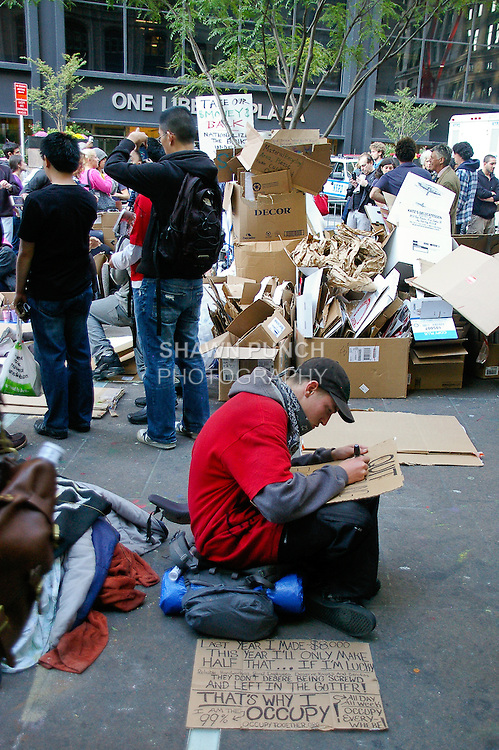 Protester writes up signs at the Occupy Wall Street Protest in New York City October 6, 2011.