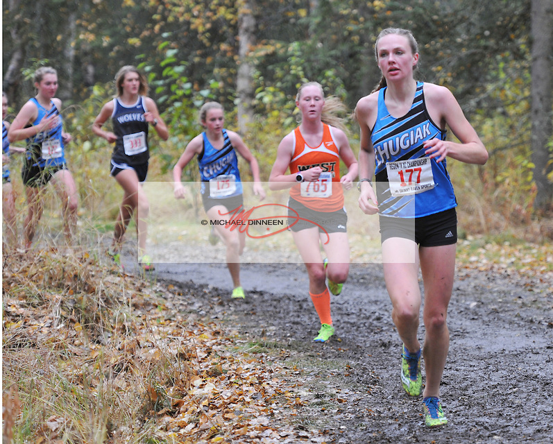 Chugiak's Emma Nelson leads the field around a turn at Saturday's Region IV Championships.  Behind Nelson are Chugiak's KayLee Manwaring (175),  Eagle River's Peyton Young (333) and Chugiak's Hannah Booher (172).  Photo for the Star by Michael Dinneen.