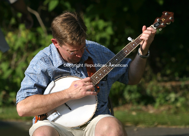 ROXBURY, CT 7/14/07- 071407BZ14- David Douyard, of Newtown, warms up on the banjo before performing at the 33rd Annual Roxbury Pickin' and Fiddlin' Contest  at Hurlburt Park Saturday. The event is sponsored by the Roxbury Volunteer Fire Department.<br /> Jamison C. Bazinet Republican-American