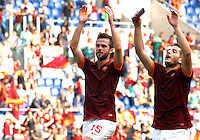 Calcio, Serie A: Roma vs Cagliari. Roma, stadio Olimpico, 21 settembre 2014.<br /> Roma midfielder Miralem Pjanic, of Bosnia, and defender Kostas Manolas, of Greece, greet fans at the end of the Italian Serie A football match between AS Roma and Cagliari at Rome's Olympic stadium, 21 September 2014. AS Roma won 2-0.<br /> UPDATE IMAGES PRESS/Riccardo De Luca