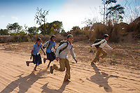 Indian schoolboys and girls walking to school at Doeli in Sawai Madhopur, Rajasthan, Northern India