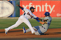 Tennessee Smokies second baseman Arismendy Alcantara #7 attempts to take the throw from catcher as Joc Pederson #29 slides in safely during a game against the Chattanooga Lookouts  at Smokies Park on April 10, 2013 in Kodak, Tennessee. The Lookouts won 6-2. (Tony Farlow/Four Seam Images).