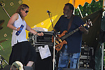 Joan Osborne, with Wendell Holmes of  The Holmes Brothers Band, performing, at the Rainbow Stage at the 2012 Clearwater Festival at Croton Point Park on Saturday, June 16, 2012. Photograph taken by Jim Peppler. Copyright Jim Peppler/2012.