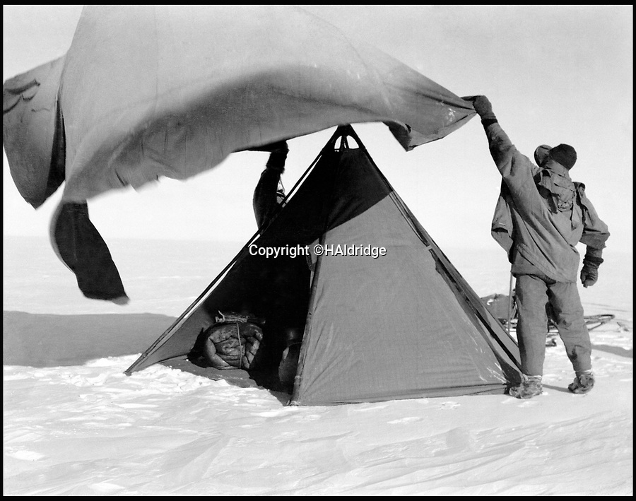 BNPS.co.uk (01202 558833)<br /> Pic: HAldridge/BNPS<br /> <br /> This picture shows the constant gales that blew across the exposed ice shelf.<br /> <br /> Poignant unseen photographs taken by Lt Bowers of Scott's ill-fated 1912 Antarctic expedition have come to light. <br /> <br /> Bowers perished with Scott on their return from the South Pole, but these photographs taken by him were returned to Britain with expedition photographer Herbert Ponting.<br /> <br /> They show the team with their dogs and ponies on the Ross Ice Shelf preparing for their doomed departure for the Pole.