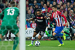 Karim Bellarabi of Bayer 04 Leverkusen competes for the ball with  Lucas Hernandez of Atletico de Madrid during the match of Uefa Champions League between Atletico de Madrid and Bayer Leverkusen at Vicente Calderon Stadium  in Madrid, Spain. March 15, 2017. (ALTERPHOTOS / Rodrigo Jimenez)