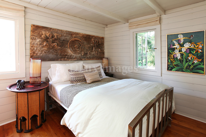 white wall paneling in the bedroom