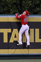 Mike Trout #27 of the Los Angeles Angels climbs the wall in a attempt to catch a home run ball against the Seattle Mariners at Angel Stadium on June 5, 2012 in Anaheim,California. Los Angeles defeated Seattle 6-1.(Larry Goren/Four Seam Images)