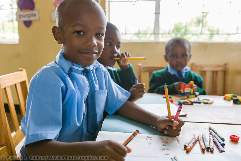 Young boy in a school classroom in the small village of Usa River, Tanzania, East Africa