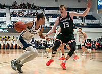 WASHINGTON, DC - JANUARY 29: Mike Jones #13 of Davidson defends against Armel Potter #2 of George Washington during a game between Davidson and George Wshington at Charles E Smith Center on January 29, 2020 in Washington, DC.