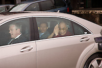 The Dalai Lama leaves Nottingham Station in a Mercedes Benz after traveling up from London for his speaking engagement at Nottingham Arena