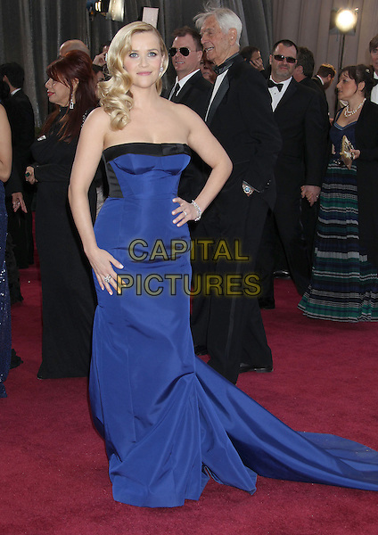 Reese Witherspoon (wearing Louis Vuitton).85th Annual Academy Awards held at the Dolby Theatre at Hollywood & Highland Center, Hollywood, California, USA..February 24th, 2013.oscars full length dress hand on hip black strapless cobalt blue train .CAP/ADM/RE.©Russ Elliot/AdMedia/Capital Pictures.