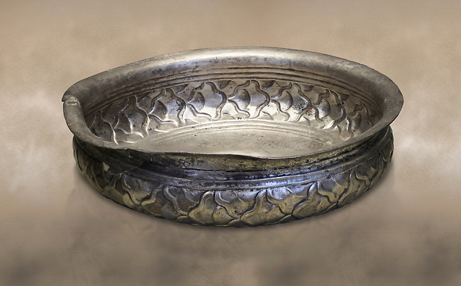 Mycenaean silver cup from the Tomb 78 of the Mycenae chamber tombs, Greece. National Archaeological Museum Athens.<br /> <br /> This Mycenaean silver cup has a repousse  scale pattern with wish bone handles. Cat No 3121. 16th Cent BC