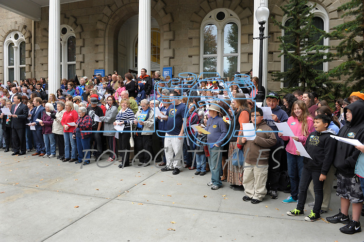 "Hundreds sing on the Capitol steps Thursday, Oct. 30, 2014 during #NevadaSings!, a statewide sing-a-long of ""Home Means Nevada."" Approximately 370 people took part  in the Carson City portion of the event, which seeks to establish a new record for the most people in an American state to sing their state song at the same time."