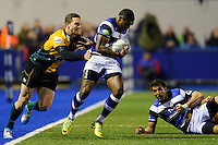 Semesa Rokoduguni looks to get past George North. Amlin Challenge Cup Final, between Bath Rugby and Northampton Saints on May 23, 2014 at the Cardiff Arms Park in Cardiff, Wales. Photo by: Rogan Thomson / Onside Images