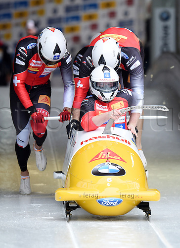 28.02.2016. Koenigssee, Germany.  Swiss bobbers Francesco Rico Peter, Janne Bror van der Zijde, Thomas Amrhein and Fabio Badraun  take off during the Bobsled World Cup in Koenigssee, Germany, 28 February 2016.