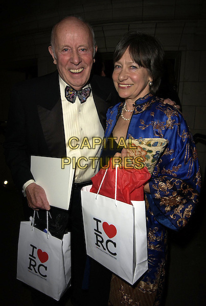 RICHARD WILSON & GUEST.The Royal Court Theatre 50th Anniversary Gala Party, Titanic Nightclub, London, UK..April 26th, 2006.Ref: CAN.half length bow tie goody bag heart I RC.www.capitalpictures.com.sales@capitalpictures.com.©Capital Pictures