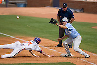 Dustin Ackley #13 of the North Carolina Tar Heels waits for the throw as Matt Sanders #21 of the Clemson Tigers dives back into first base at Durham Bulls Athletic Park May 23, 2009 in Durham, North Carolina. The Tigers defeated the Tar Heals 4-3 in 11 innings.  (Photo by Brian Westerholt / Four Seam Images)