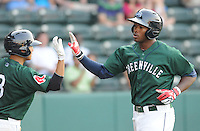 Outfielder Brandon Jacobs (24) of the Greenville Drive is congratulated after hitting a home run in a game against the Augusta GreenJackets on April 10, 2011, at Fluor Field at the West End in Greenville, South Carolina. (Tom Priddy / Four Seam Images)