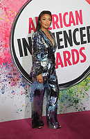 18 November 2019 - Hollywood, California - Jeannie Mai. 2019 American Influencer Awards held at Dolby Theatre. Photo Credit: FS/AdMedia