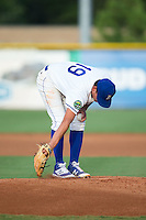 Burlington Royals starting pitcher Garrett Davila (19) cleans off the pitching rubber during the game against the Kingsport Mets at Burlington Athletic Stadium on July 18, 2016 in Burlington, North Carolina.  The Royals defeated the Mets 8-2.  (Brian Westerholt/Four Seam Images)