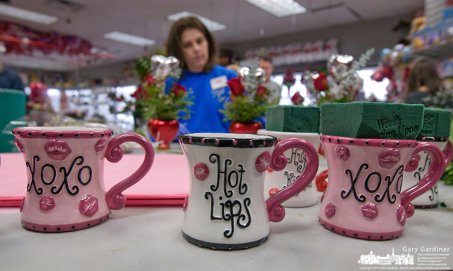 Coffee cups are prepared to hold Valentines Day flower arrangements at Flowerama on South State Street. Valentines Day and Mothers Day are the two busiest holidays for the florist. Photo Copyright Gary Gardiner. Not be used without written permission detailing exact usage.
