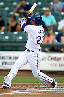 Round Rock Express outfielder Leonys Martin #27 swings during the Pacific Coast League baseball game against the Las Vegas 51s on August 7th, 2012 at the Dell Diamond in Round Rock, Texas. The Express defeated the 51s 5-4. (Andrew Woolley/Four Seam Images).