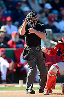 Home plate umpire Toby Basner during a spring Training game between the Philadelphia Phillies and Washington Nationals at Bright House Field on March 6, 2013 in Clearwater, Florida.  Philadelphia defeated Washington 6-3.  (Mike Janes/Four Seam Images)