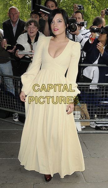 LILY ALLEN .Attending the Ivor Novello Awards, Grosvenor House Hotel, Park Lane, London, England, UK, May 20th 2010..arrivals full length yellow long maxi dress sleeves sleeved v-neck low cut .CAP/CAN.©Can Nguyen/Capital Pictures.
