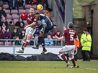 John-Joe O'Toole of Northampton Town and Gozie Ugwu of Wycombe Wanderers during the Sky Bet League 2 match between Northampton Town and Wycombe Wanderers at Sixfields Stadium, Northampton, England on the 20th February 2016. Photo by Liam McAvoy.