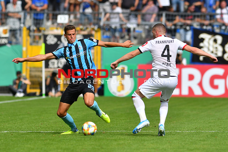 11.08.2019, Carl-Benz-Stadion, Mannheim, GER, DFB Pokal, 1. Runde, SV Waldhof Mannheim vs. Eintracht Frankfurt, <br /> <br /> DFL REGULATIONS PROHIBIT ANY USE OF PHOTOGRAPHS AS IMAGE SEQUENCES AND/OR QUASI-VIDEO.<br /> <br /> im Bild: Michael Schultz (SV Waldhof Mannheim #23), Ante Rebic (Eintracht Frankfurt #4)<br /> <br /> Foto © nordphoto / Fabisch