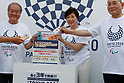 Tokyo governor Yuriko Koike (C) drops an old phone on a recycling box for medals during the 3 Years to Go! ceremony for the Tokyo 2020 Paralympic games at Urban Dock LaLaport Toyosu on August 25, 2017. The Games are set to start on August 25th 2020. (Photo by Rodrigo Reyes Marin/AFLO)