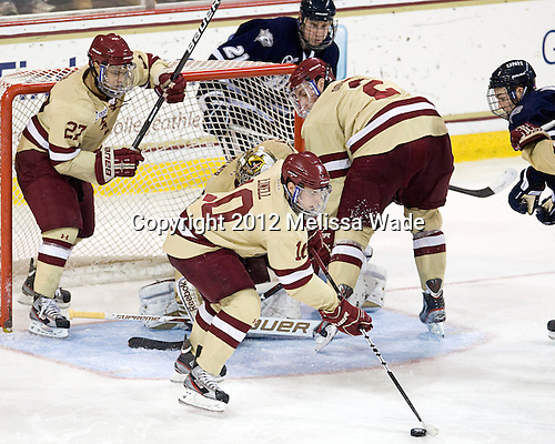 Quinn Smith (BC - 27), Danny Linell (BC - 10), Brian Dumoulin (BC - 2) - The Boston College Eagles defeated the visiting University of New Hampshire Wildcats 4-3 on Friday, January 27, 2012, in the first game of a back-to-back home and home at Kelley Rink/Conte Forum in Chestnut Hill, Massachusetts.