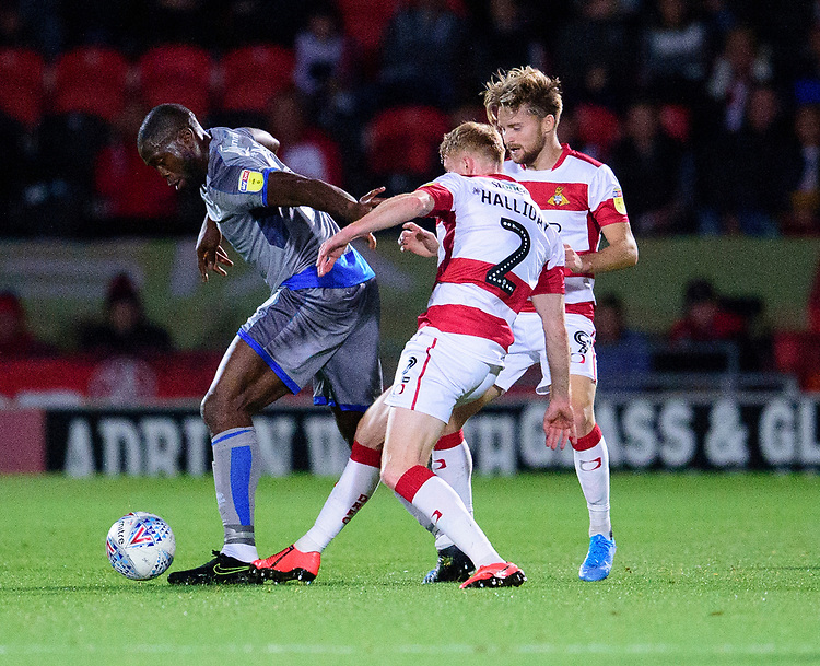 Lincoln City's John Akinde battles with Doncaster Rovers' Brad Halliday<br /> <br /> Photographer Andrew Vaughan/CameraSport<br /> <br /> EFL Leasing.com Trophy - Northern Section - Group H - Doncaster Rovers v Lincoln City - Tuesday 3rd September 2019 - Keepmoat Stadium - Doncaster<br />  <br /> World Copyright © 2018 CameraSport. All rights reserved. 43 Linden Ave. Countesthorpe. Leicester. England. LE8 5PG - Tel: +44 (0) 116 277 4147 - admin@camerasport.com - www.camerasport.com
