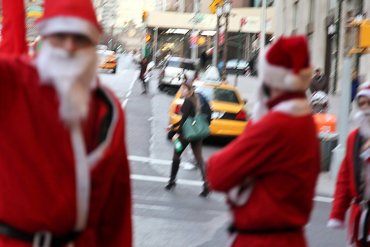 NEW YORK, NY - DECEMBER 10: Revelers dressed as Santa Claus during the annual SantaCon event December 10, 2011 in New York City. (Photo by Donald Bowers)
