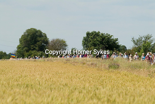 Pilgrimage walk to  St Peters Chapel which was founded by St Cedd in AD 654 from the church of St Thomas in Bradwell on Sea Essex England 2009.