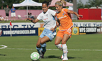Red Stars defender Jill Oakes knocks the ball away from Sky Blue forward Kacey White. Sky Blue defeated the Chicago Red Stars 1-0 on Sunday, July 19, 2009.