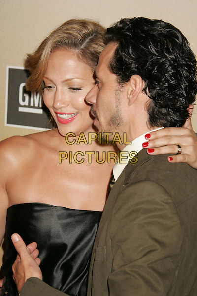 "JENNIFER LOPEZ & MARC ANTHONY .Women In Film presents ""Film Brings US The World"" - The 2006 Crystal and Lucy Awards held at the Century Plaza Hotel. .June 6th, 2006.Photo: Russ Elliot/AdMedia/Capital Pictures.Ref: RE/ADM.headshot portrait married husband wife red nail polish varnish.www.capitalpictures.com.sales@capitalpictures.com.© Capital Pictures."