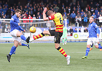 Andy Stirling (left) and Sean McGinty challenge for the ball in the SPFL Ladbrokes Championship football match between Queen of the South and Partick Thistle at Palmerston Park, Dumfries on  4.5.19.